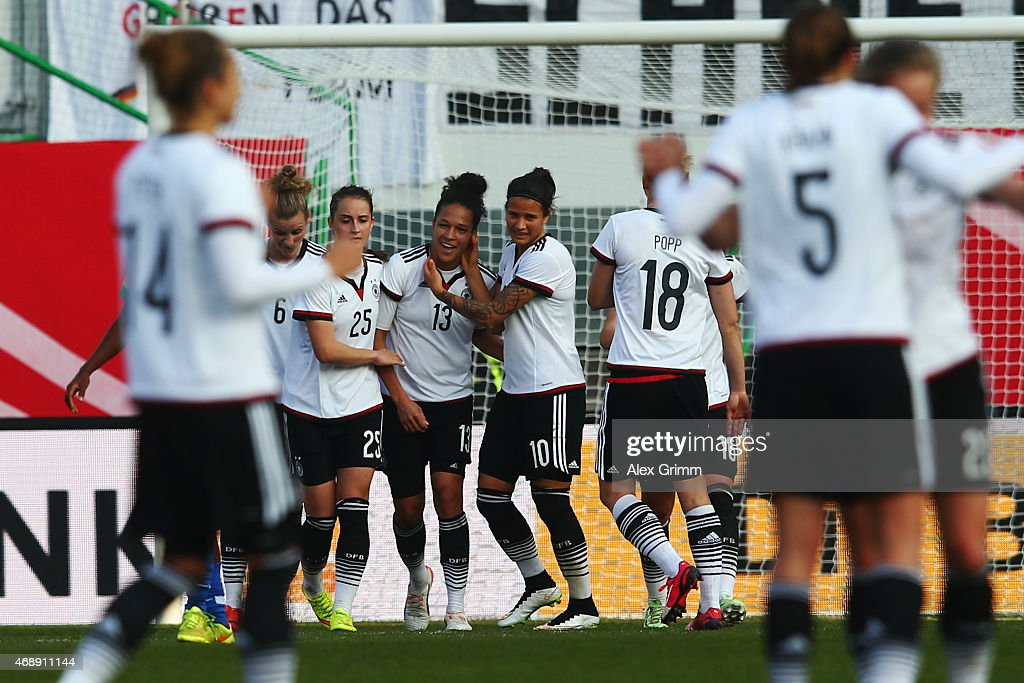 Celia Sasic #13 of Germany celebrates his team's first goal with team mates during the Women's International Friendly match between Germany and Brazil at Trolli-Arena on April 8, 2015 in Fuerth, Germany.