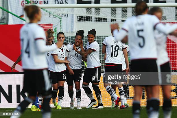Celia Sasic of Germany celebrates his team's first goal with team mates during the Women's International Friendly match between Germany and Brazil at...