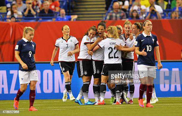 Celia Sasic of Germany celebrates scoring her penalty goal during the quarter final match of the FIFA Women's World Cup between Germany and France at...