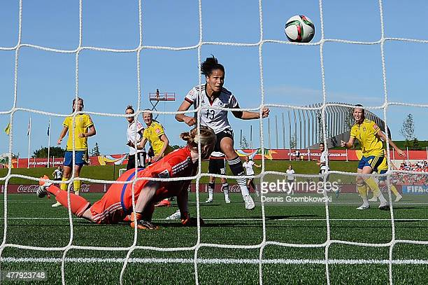 Celia Sasic of Germany scores the third goal past goalkeeper Hedvig Lindahl of Sweden during the FIFA Women's World Cup Canada 2015 Round of 16 match...