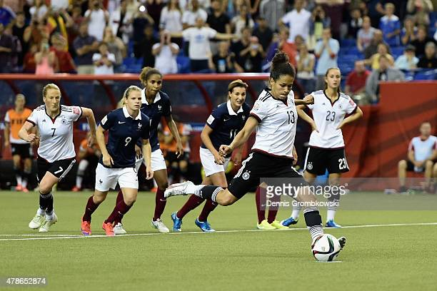 Celia Sasic of Germany scores their first goal from a penalty during the FIFA Women's World Cup Canada 2015 Quarter Final match between Germany and...
