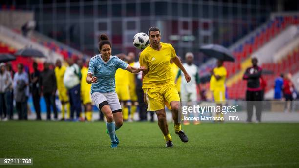 Celia Sasic OFC competes with Noureddine Naybet of CAF during the FIFA Congress Delegation Football Tournament at CSKA Arena during the on June 12...