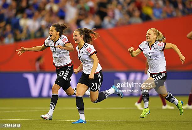 Celia Sasic, Sara Daebritz and Leonie Maier of Germany celebrate winning the quarter final match of the FIFA Women's World Cup between Germany and...