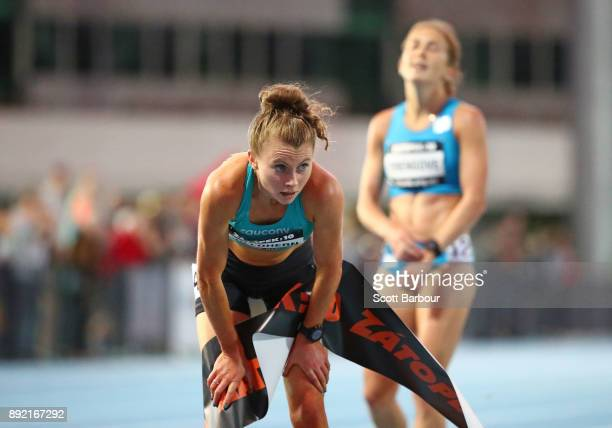 Celia Sullohern of New South Wales crosses the finish line to win the Womens 10000 Meter Run Open Zatopek race ahead of Jessica Trengove of South...