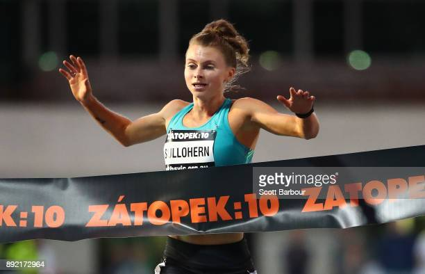Celia Sullohern of New South Wales crosses the finish line to win the Womens 10000 Meter Run Open Zatopek race during Zatopek 10 at Lakeside Stadium...