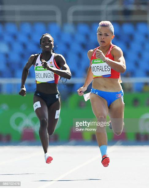 Celiangeli Morales of Puerto Rico and Cynthia Bolingo of Belgium compete in round one of the Women's 200m on Day 10 of the Rio 2016 Olympic Games at...