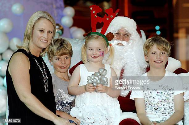 Celina Edmonds poses with Santa Claus at Bondi Junction Westfield on November 16, 2007 in Sydney, Australia.