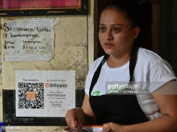 Celina fuentas attends a costumer at her Store where she accepts bitcoins in El zonte, 56 km south east from San Salvador, on June 09, 2021. -...