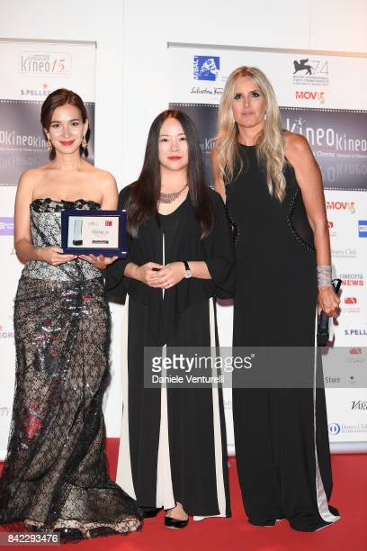 Celina Jade guest and Tiziana Rocca pose with the award at the Kineo Diamanti Awards during the 74th Venice Film Festival at Excelsior Hotel on...