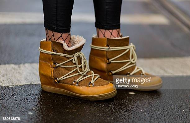 Celina Ruf wearing net tights beige Isabel Marant Atoile fed winter boots with calfskin and wool on December 28 2016 in Berlin Germany