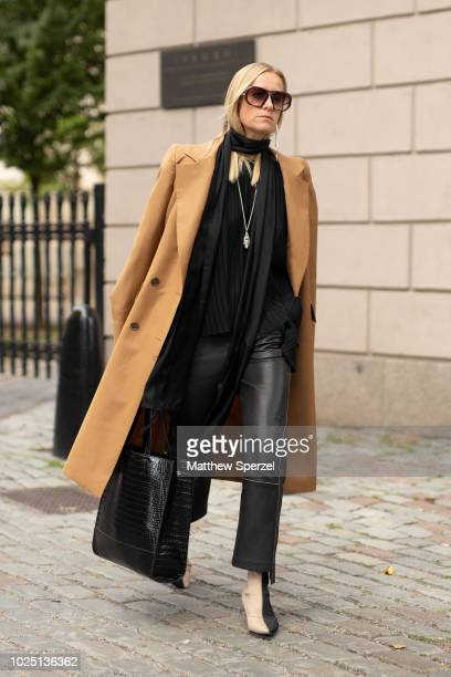 Celine Aagaard is seen on the street during Fashion Week Stockholm SS19 wearing a black outfit with long camel coat on August 29 2018 in Stockholm...