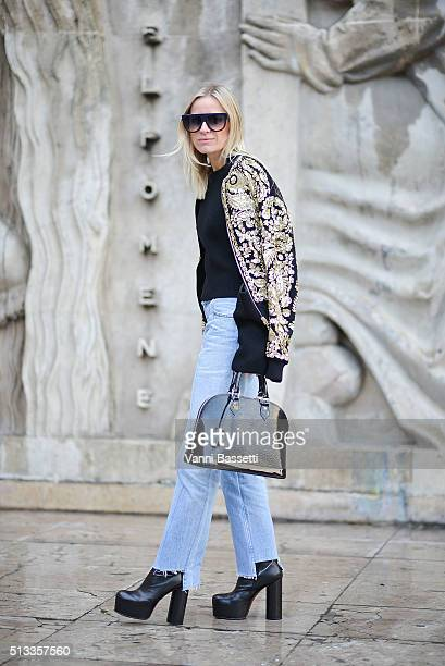 Celine Aagaard poses wearing a Rochas jacket Vetements pants and shoes and Louis Vuitton bag before the Rochas show at the Palais de Tokyo during...