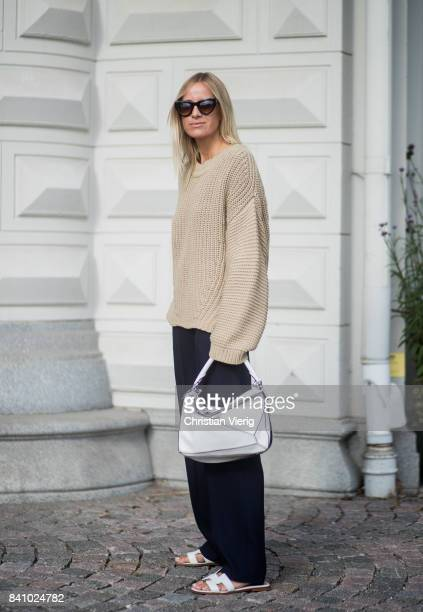 Celine Aagaard wearing a brown knit white Loewe bag sandals navy pants outside By Malina on August 30 2017 in Stockholm Sweden