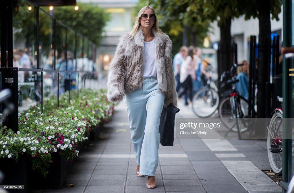 Celine Aagaard wearing a jacket, denim jeans outside Rodebjer on August 30, 2017 in Stockholm, Sweden.