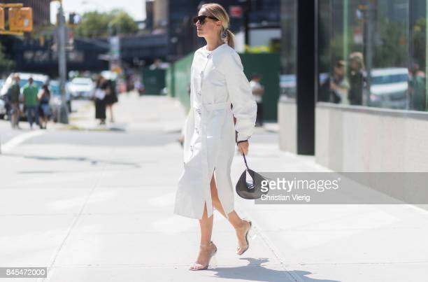 Celine Aagaard wearing a white dress seen in the streets of Manhattan outside Tome during New York Fashion Week on September 10, 2017 in New York...