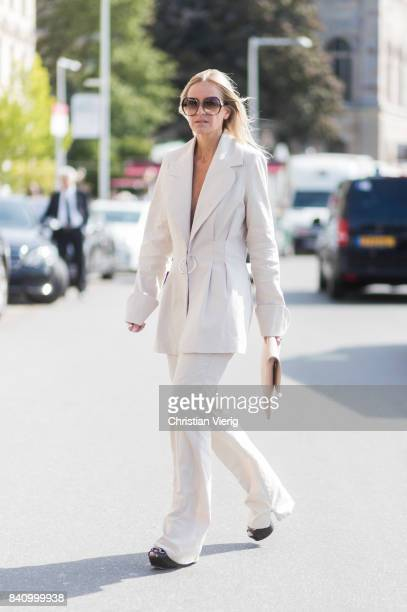 Celine Aagaard wearing a white suit NO/AN clutch outside Whyred on August 30 2017 in Stockholm Sweden
