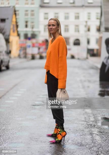 Celine Aagaard wearing an orange knit with zipper on the back Balenciaga sock boots outside Bik Bok Runway Award on August 24 2017 in Oslo Norway