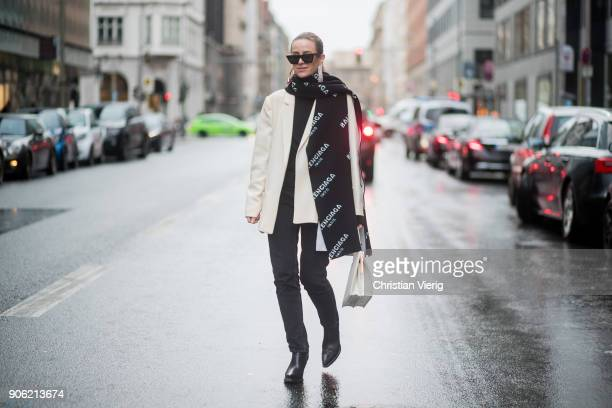 Celine Aagaard wearing Balenciaga scarf HM boots Celine bag Celine sunglasses black denim jeans is seen outside Lana Mueller during the Berlin...