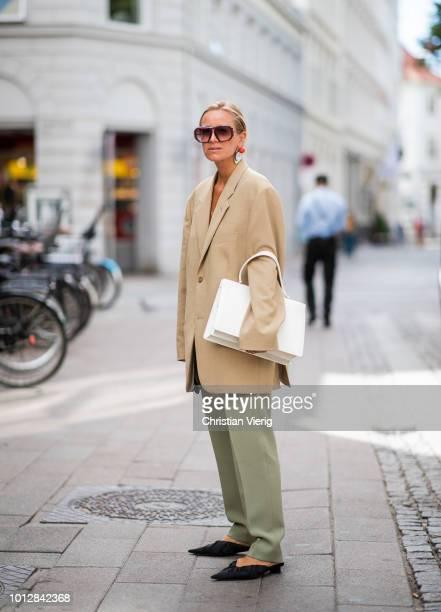 Celine Aagaard wearing beige oversized blazer, olive green pants, pointed flats seen outside Blanche during the Copenhagen Fashion Week Spring/Summer...