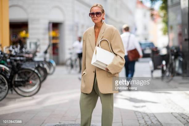 Celine Aagaard wearing beige oversized blazer olive green pants pointed flats seen outside Blanche during the Copenhagen Fashion Week Spring/Summer...