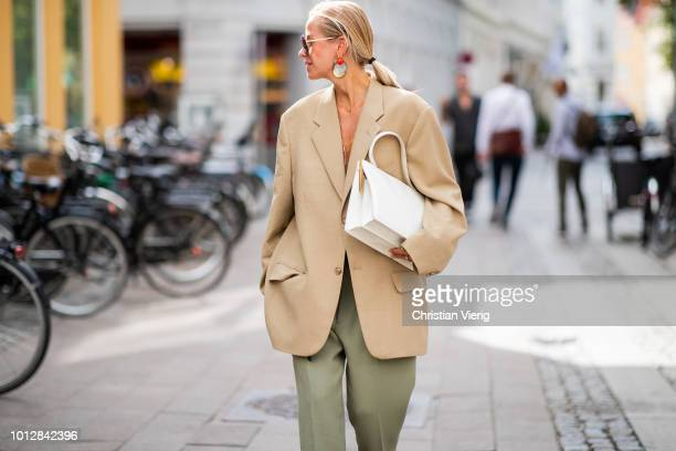 Celine Aagaard wearing beige oversized blazer olive green pants pointed flats seen outside Blanche during the Copenhagen Fashion Week Spring/Summer...