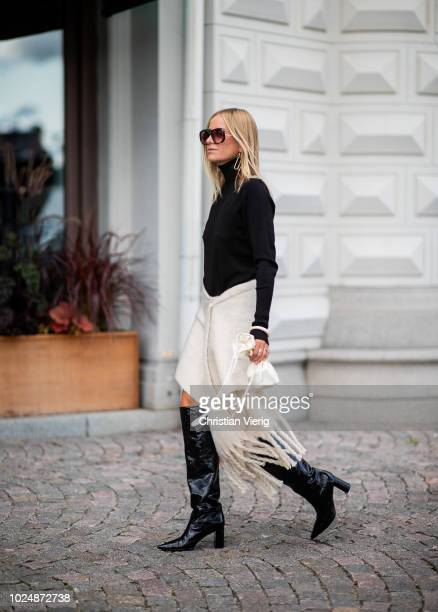 Celine Aagaard wearing black turtleneck, skirt with fringes, mini sac bag is seen during Stockholm Runway SS19 on August 28, 2018 in Stockholm,...