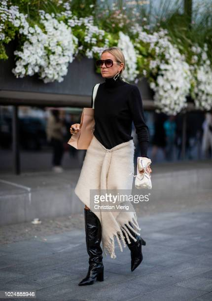 Celine Aagaard wearing black turtleneck skirt with fringes mini sac bag is seen during Stockholm Runway SS19 on August 28 2018 in Stockholm Sweden