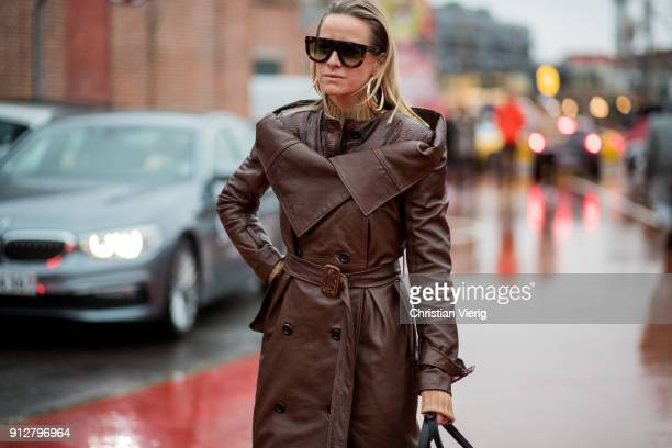 Celine Aagaard wearing brown leather coat white boots outside Freya Dalsjo during the Copenhagen Fashion Week Autumn/Winter 18 on January 31 2018 in...