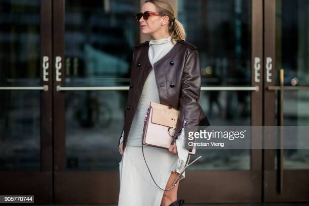 Celine Aagaard wearing Chloe bag Celine sunglasses brown leather jacket Dorothee Schumacher dress Mardou Dean black HM boots is seen during the...