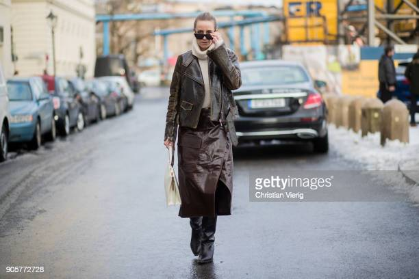 Celine Aagaard wearing Dorothee Schumacher leather jacket and brown skirt HM boots Celine bag vintage turtleneck is seen during the Berlin Fashion...