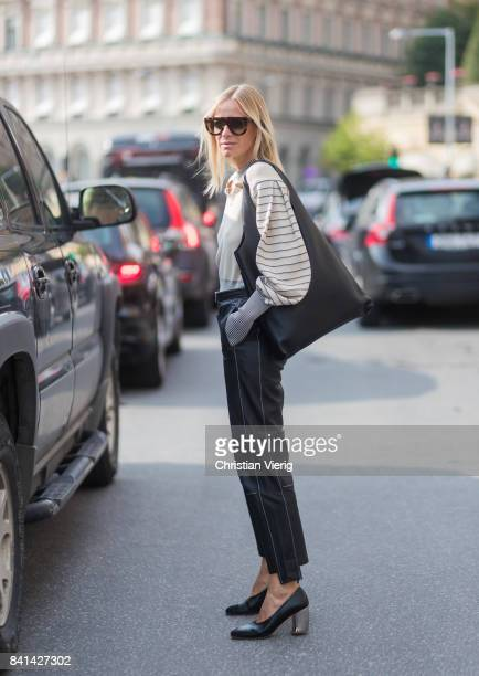 Celine Aagaard wearing navy denim jeans outside House of Dagmar on August 31 2017 in Stockholm Sweden