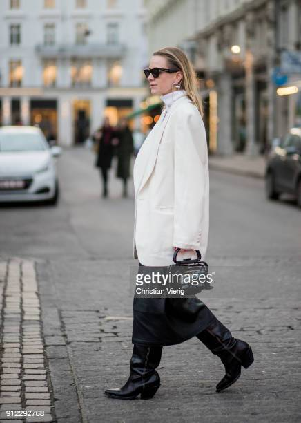 Celine Aagaard wearing white blazer jacket black skirt black HM boots black bag is seen outside Designers Nest during the Copenhagen Fashion Week...