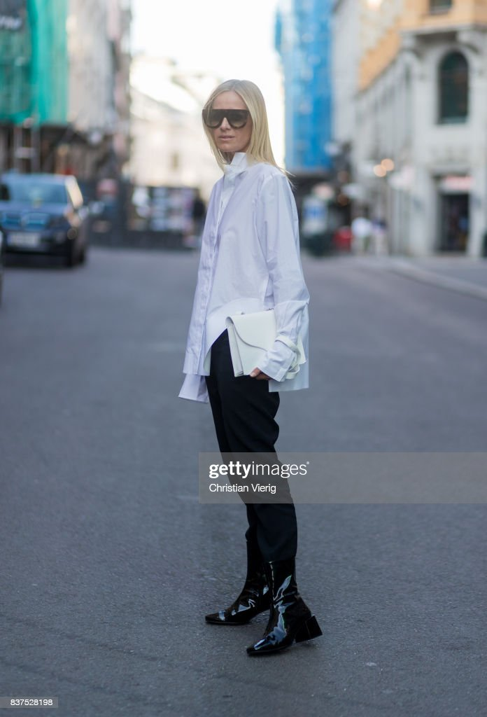 Celine Aagaard wearing white button shirt, black pants and boots outside Line of Oslo on August 22, 2017 in Oslo, Norway.