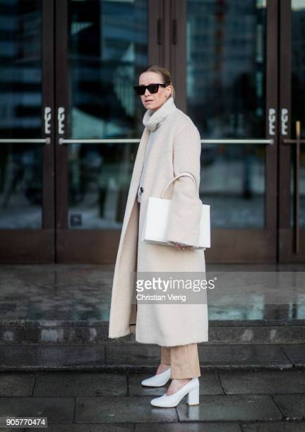 Celine Aagaard wearing white Marimekko shoes Dorothee Schumacher pants and creme coat white Celine bag Celine sunglasses is seen during the Berlin...