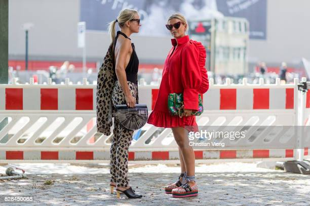 Celine Aargaard and Janka Polliani wearing red dress green Gucci bag Miu Miu shoes outside Munthe on August 09 2017 in Copenhagen Denmark