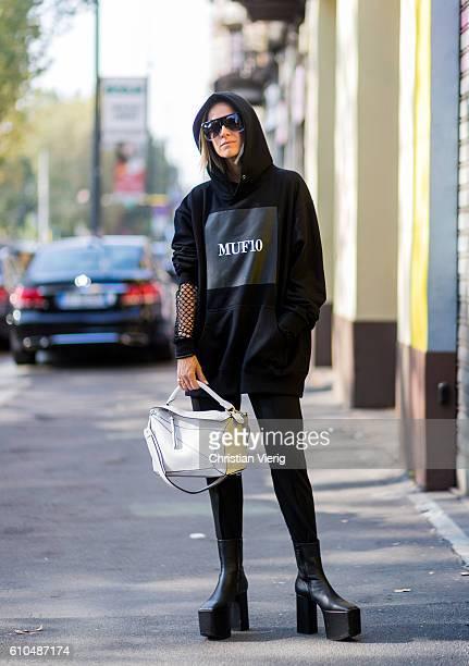 Celine Aargaard wearing a black MUF10 hoody and plattform shoes and Loewe bag outside Marni during Milan Fashion Week Spring/Summer 2017 on September...