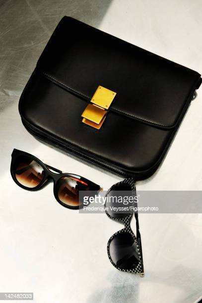 Celine bag and sunglasses designed by Thierry Lasry from AnneSophie Berbille's wardrobe are photographed for Madame Figaro on January 30 2012 in...