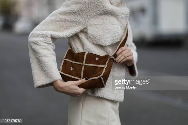 Celine Bethmann wearing a beige Weekday jacket, Chanel vintage brown bag, Zara mini skirt on November 21, 2020 in Berlin, Germany.
