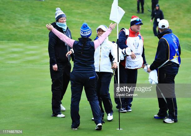 Celine Boutier and Georgia Hall of Team Europe celebrate winning their match on the eighteenth green during Day 2 of the Solheim Cup at Gleneagles on...