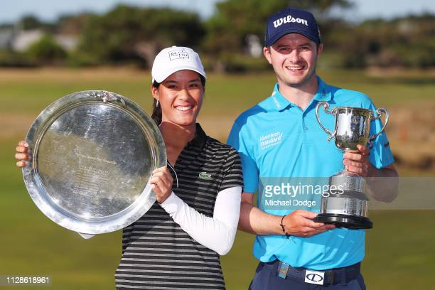 Celine Boutier of France and David Law of Scotland pose with their winners trophies during Day four of the ISPS Handa Vic Open at 13th Beach Golf...