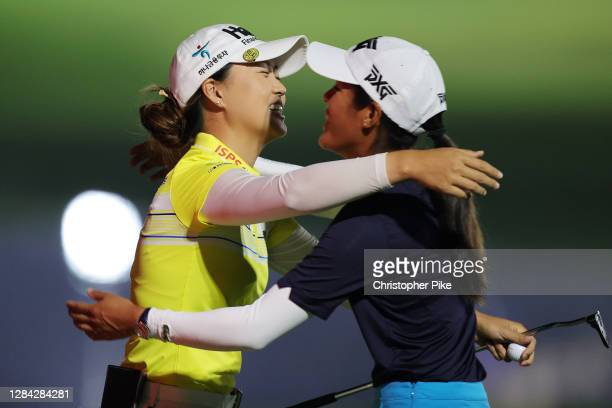 Celine Boutier of France congratulates Minjee Lee of Australia after winning the Omega Dubai Moonlight Classic at Emirates Golf Club on November 06,...