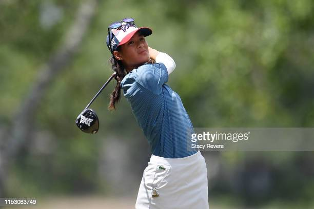 Celine Boutier of France hits her tee shot on the fifth hole during the third round of the US Women's Open Championship at the Country Club of...