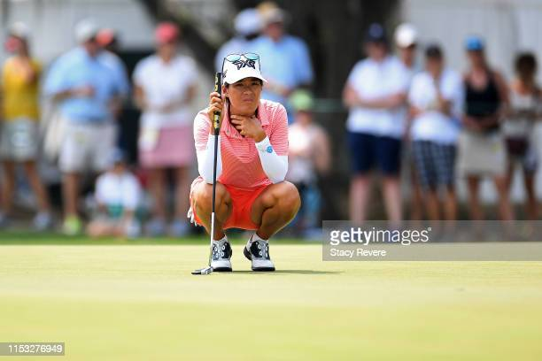 Celine Boutier of France lines up a putt on the fourth green during the final round of the US Women's Open Championship at the Country Club of...