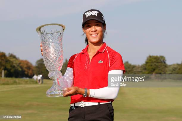 Celine Boutier of France poses with the trophy after winning the ShopRite LPGA Classic presented by Acer on the Bay Course at Seaview Golf Club on...