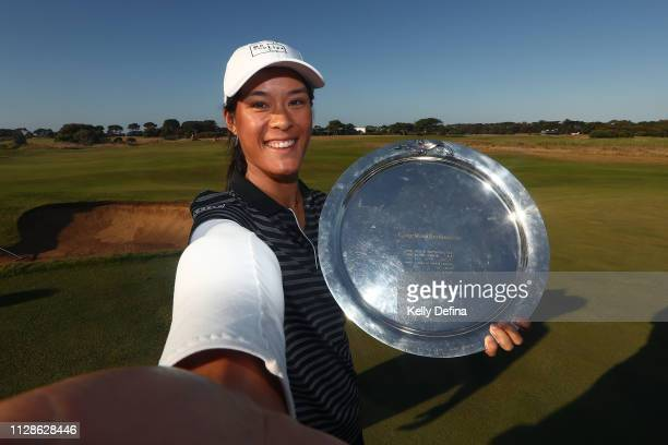 Celine Boutier of France pretends to take a selfie while holding her trophy on the 18th green during the ISPS Handa Vic Open at 13th Beach Golf Club...
