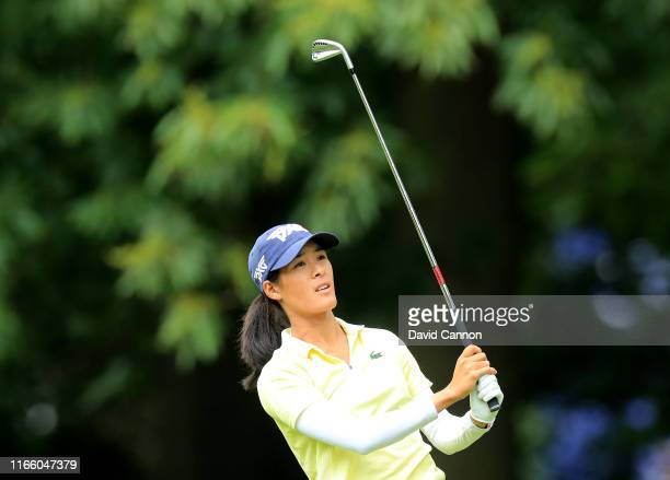 Celine Boutier of France waits to play her second shot on the par 4 first hole during the final round of the AIG Women's British Open on the Marquess...