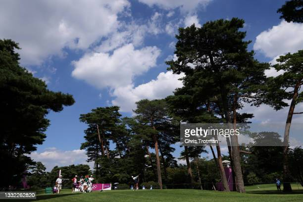 Celine Boutier of Team France plays her shot from the 18th tee during the first round of the Women's Individual Stroke Play on day twelve of the...