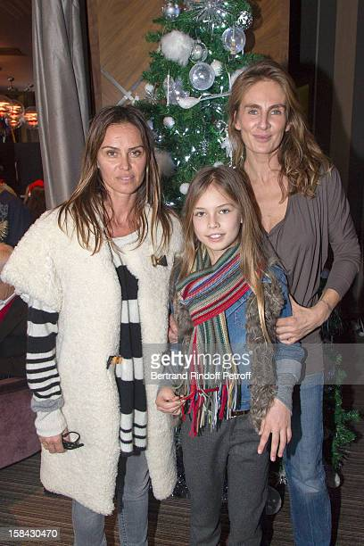 Celine Charloux President of the charity association 'Les P'tits Cracks' Agathe de la Fontaine with her daughter Zoe Petit attend the association's...