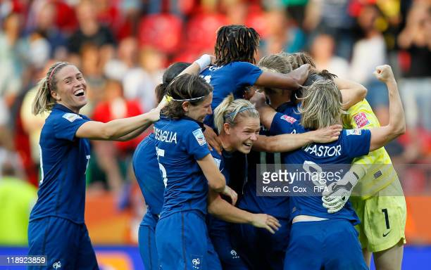 Celine Deville of France celebrates with teammates after a 54 win in a penalty shootout over England during the FIFA Women's World Cup 2011 Quarter...