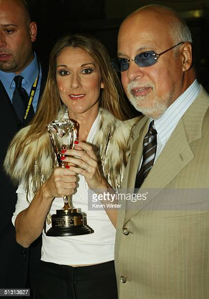 Celine Dion and husband Rene Angelil poses for a picture backstage during the 2004 World Music Awards at the Thomas and Mack Center on September 15...